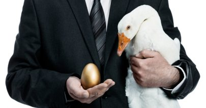 Businessman with golden egg